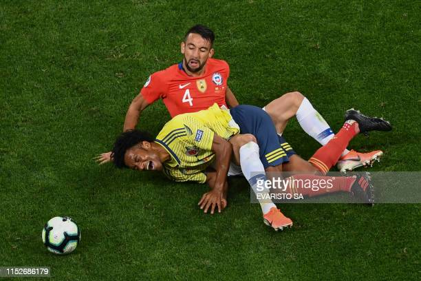 TOPSHOT Chile's Mauricio Isla and Colombia's Juan Guillermo Cuadrado lie on the ground during their Copa America football tournament quarterfinal...