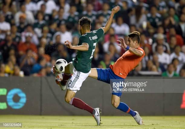 Chile's Mauricio Isla vies for the ball with Mexico's Nestor Araujo during their friendly football match at the La Corregidora stadium in Queretaro...