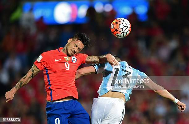 Chile's Mauricio Pinilla and Argentina's Ramiro Funes Mori jump for a header during their Russia 2018 FIFA World Cup South American Qualifiers'...