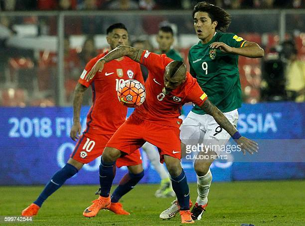 Chile's midfielder Arturo Vidal and Bolivia's Pablo Escobar vie for the ball during their Russia 2018 FIFA World Cup football qualifier match Chile...