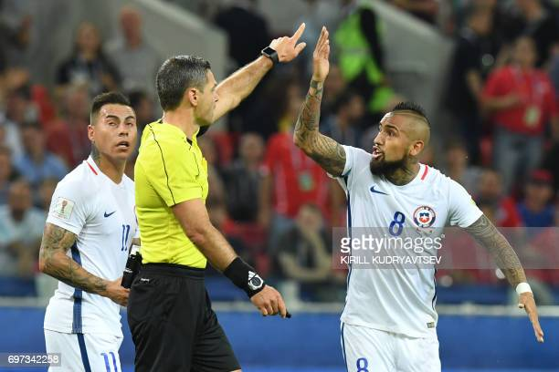 Chile's midfielder Arturo Vidal argues with Slovenian referee Damir Skomina after a goal was ruled offside during the 2017 Confederations Cup group B...