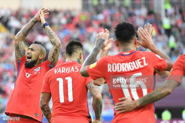 TOPSHOT Chile's midfielder Arturo Vidal celebrates after Chile's forward Martin Rodriguez scored a goal during the 2017 Confederations Cup group B...