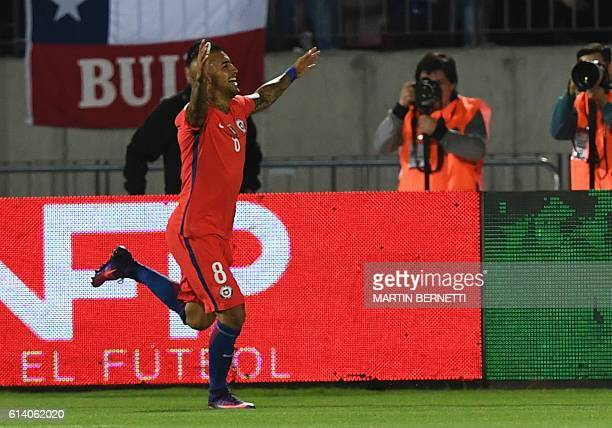Chile's midfielder Arturo Vidal celebrates after scoring against Peru during their Russia 2018 World Cup qualifier football match in Santiago on...
