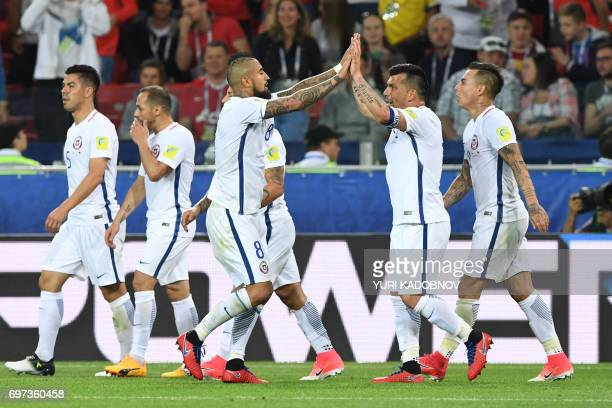 TOPSHOT Chile's midfielder Arturo Vidal celebrates with teammates after scoring a goal during the 2017 Confederations Cup group B football match...