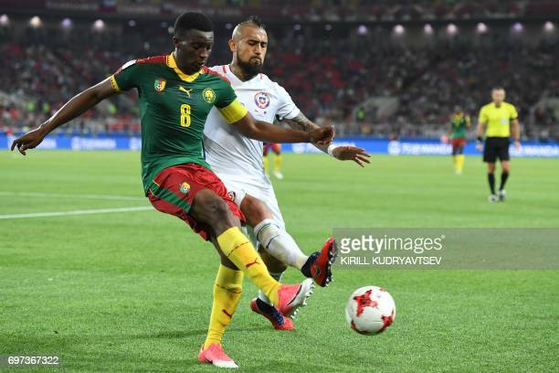 Chile's midfielder Arturo Vidal challenges Cameroon's forward Benjamin Moukandjo during the 2017 Confederations Cup group B football match between...