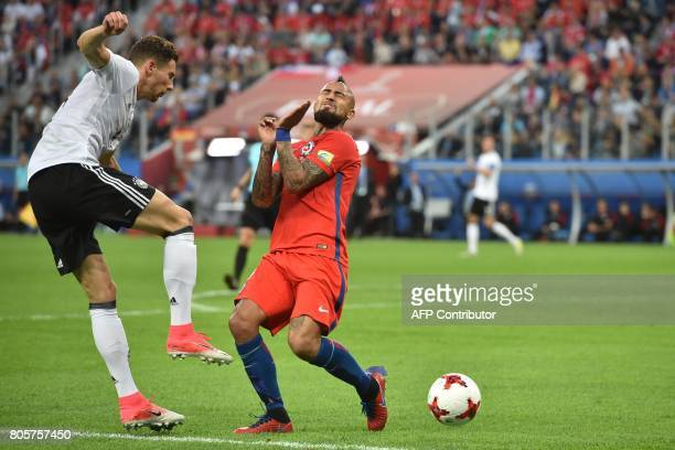 Chile's midfielder Arturo Vidal challenges Germany's midfielder Leon Goretzka during the 2017 Confederations Cup final football match between Chile...