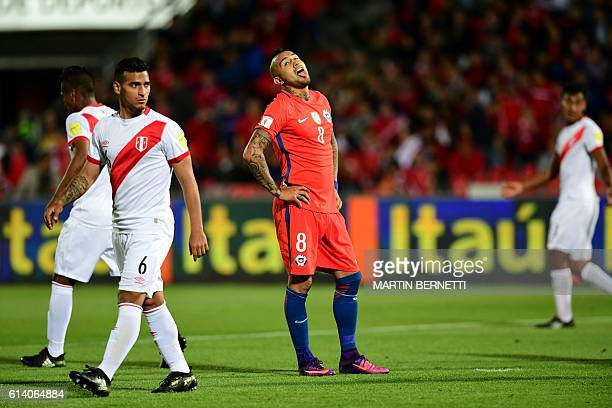 Chile's midfielder Arturo Vidal gestures during the Russia 2018 FIFA World Cup qualifier football match against Peru in Santiago on October 11 2016 /...