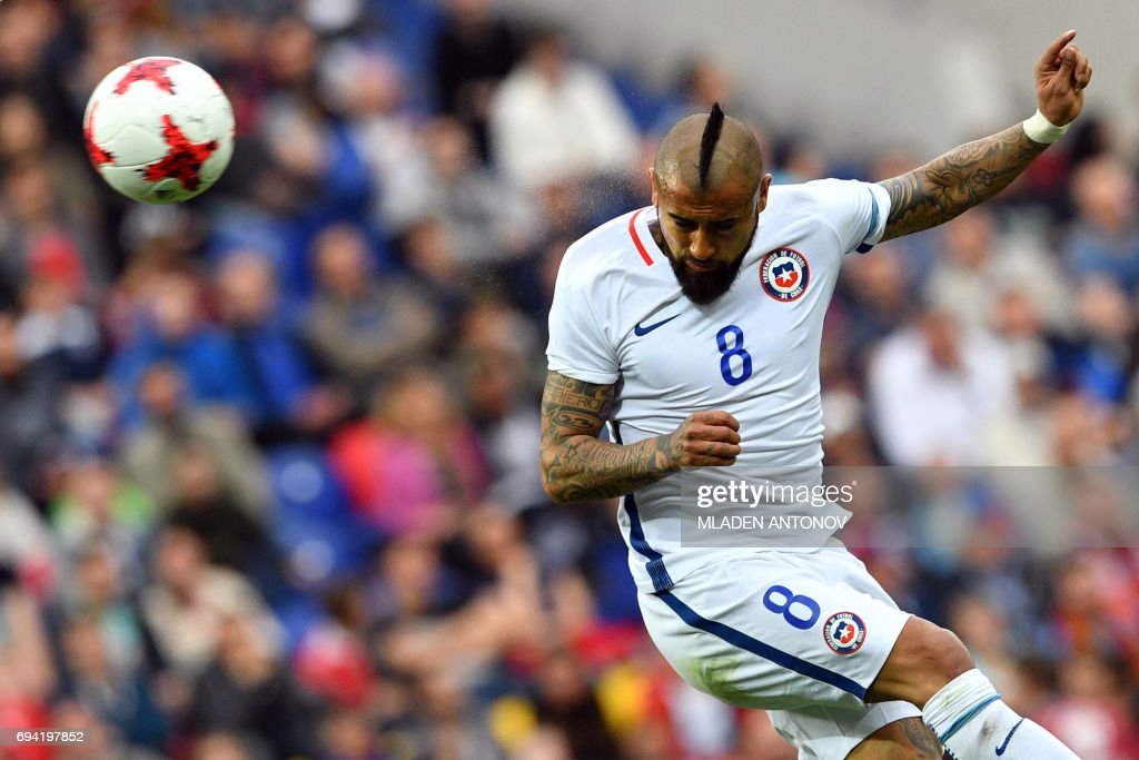 Chile's midfielder Arturo Vidal heads the ball during a friendly football match between Russia and Chile at the CSKA Arena in Moscow on June 9, 2017. / AFP PHOTO / Mladen ANTONOV