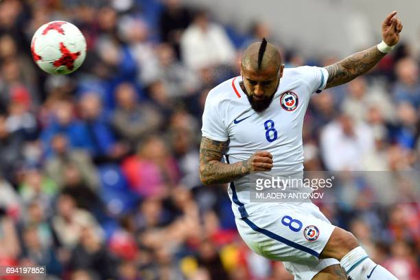 Chile's midfielder Arturo Vidal heads the ball during a friendly football match between Russia and Chile at the CSKA Arena in Moscow on June 9 2017 /...