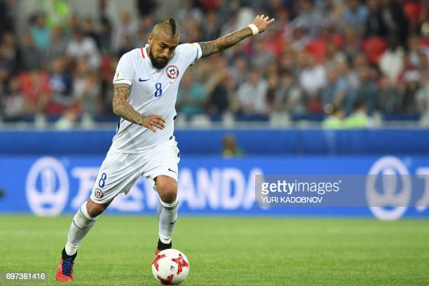Chile's midfielder Arturo Vidal prepares to kick the ball during the 2017 Confederations Cup group B football match between Cameroon and Chile at the...
