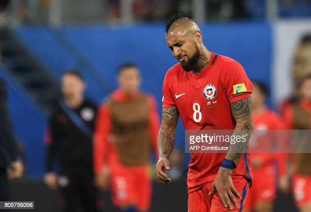 Chile's midfielder Arturo Vidal reacts after Chile's defeat during the 2017 Confederations Cup final football match between Chile and Germany at the...
