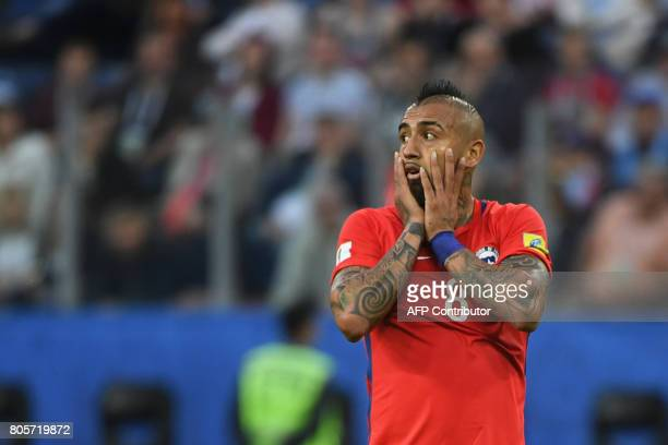 TOPSHOT Chile's midfielder Arturo Vidal reacts during the 2017 Confederations Cup final football match between Chile and Germany at the Saint...