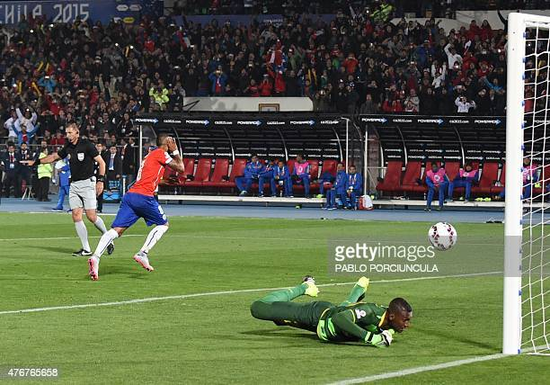 Chile's midfielder Arturo Vidal runs to celebrate after scoring a penalty against Ecuador's goalkeeper Alexander Dominguez during the Copa America...