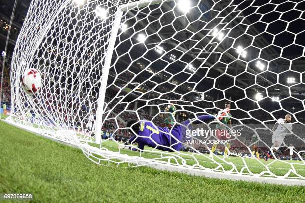 Chile's midfielder Arturo Vidal scores a goal during the 2017 Confederations Cup group B football match between Cameroon and Chile at the Spartak...