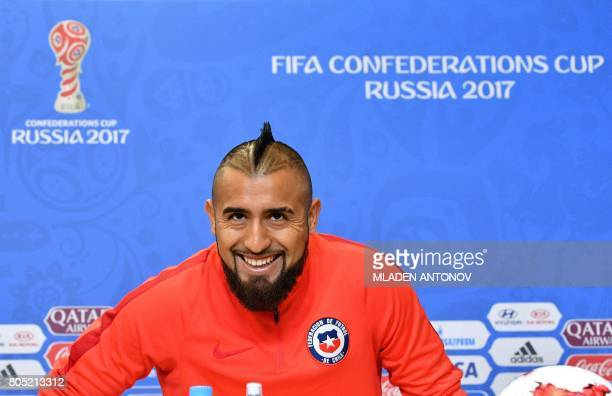 Chile's midfielder Arturo Vidal smiles during a press conference at Krestovsky Stadium in Saint Petersburg on July 1 the eve of Chile's 2017 FIFA...