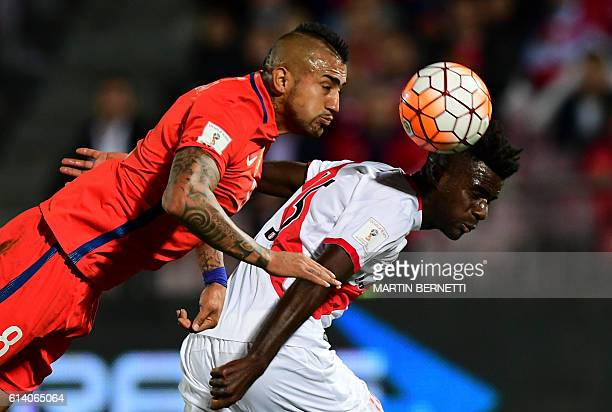TOPSHOT Chile's midfielder Arturo Vidal vies for the ball with Peru's defender Christian Ramos during their Russia 2018 FIFA World Cup qualifier...