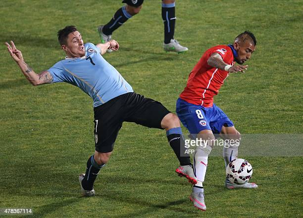 Chile's midfielder Arturo Vidal vies for the ball with Uruguay's midfielder Cristian Rodriguez during their 2015 Copa America football championship...