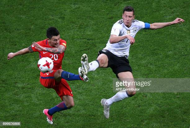 Chile's midfielder Charles Aranguiz vies with Germany's midfielder Julian Draxler during the 2017 Confederations Cup group B football match between...