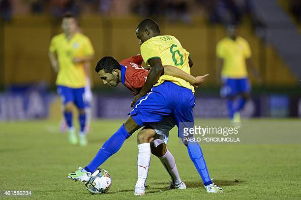 Chile's midfielder Cristian Cuevas vies for the ball with Brazil's defender Caju during a South American U-20 football match at Domingo Burgueno...