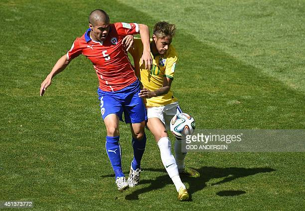 Chile's midfielder Francisco Silva and Brazil's forward Neymar vie for the ball during the Round of 16 football match between Brazil and Chile at the...