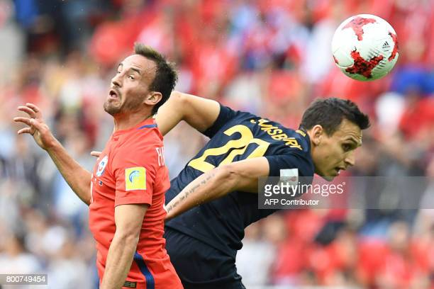 TOPSHOT Chile's midfielder Jose Fuenzalida vies with Australia's defender Trent Sainsbury during the 2017 Confederations Cup group B football match...