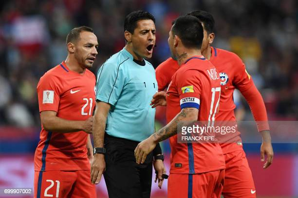 TOPSHOT Chile's midfielder Marcelo Diaz and Chile's defender Gary Medel argue with Iranian referee Alireza Faghani during the 2017 Confederations Cup...
