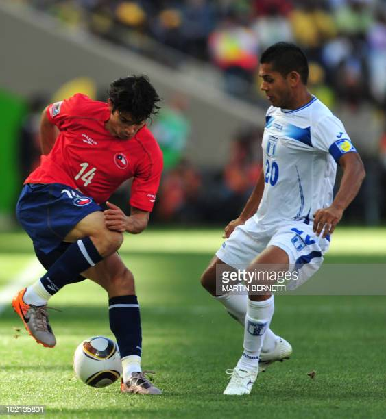 Chile's midfielder Matias Fernandez controls the ball in front of Honduras' midfielder Amado Guevara during the Group H first round 2010 World Cup...
