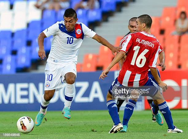 Chile's midfielder Nicolas Maturana vies for the ball with Paraguay's midfielder Miguel Almiron during their Group A South American U20 qualifier...