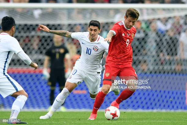 Chile's midfielder Pablo Hernandez and Russia's forward Fedor Smolov vie for the ball during a friendly football match between Russia and Chile at...