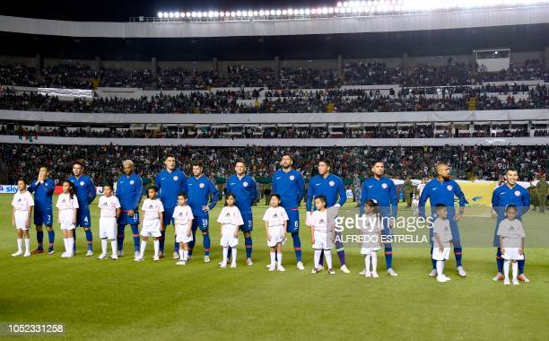 Chile's national football team players listen to their national anthem before the start of the friendly football match between Mexico and Chile at...