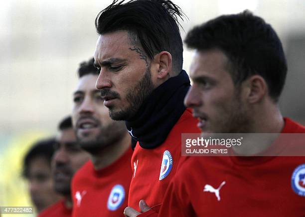 Chile's national football team players Mauricio Pinilla and Angelo Henriquez take part in a training session in Santiago during the Copa America 2015...