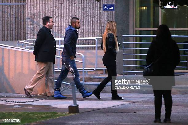 Chile's national team player Arturo Vidal and his wife Maria Matus arrive in court in the town of San Bernardo Chile on July 8 to face charges for...
