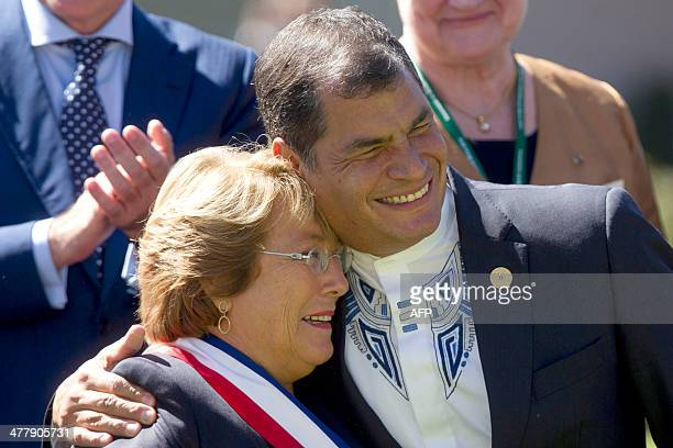 Chile's new President Michelle Bachelet poses with Ecuador's President Rafael Correa at Cerro Castillo Palace in Vina Del Mar Chile on March 11 2014...