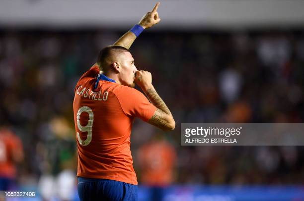Chile's Nicolas Castillo celebrates his goal against Mexico during the friendly football match between Mexico and Chile at the La Corregidora stadium...