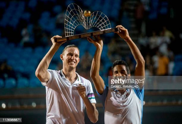 Chile's Nicolas Jarry and Argentina's Maximo Gonzalez celebrate with their trophy after winning the ATP World Tour Rio Open doubles final against...