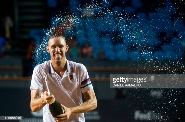 TOPSHOT Chile's Nicolas Jarry sprays champagne as he celebrates after winning along with Argentina's Maximo Gonzalez the ATP World Tour Rio Open...