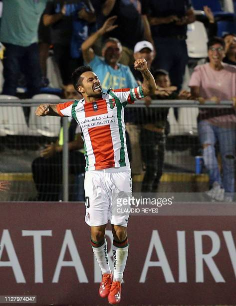 Chile's Palestino midfielder Luis Jimenez celebrates his goal against Argentina's Talleres de Cordoba during a Copa Libertadores football match at...