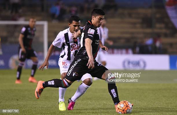 Chile's Palestino player Esteban Carvajal vies for the ball with Sergio Aquino of Paraguay's Libertad during their Copa Sudamericana football match...