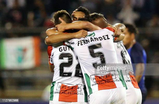 Chile's Palestino players celebrate a goal against Argentina's Talleres de Cordoba during a Copa Libertadores football match at San Carlos de...