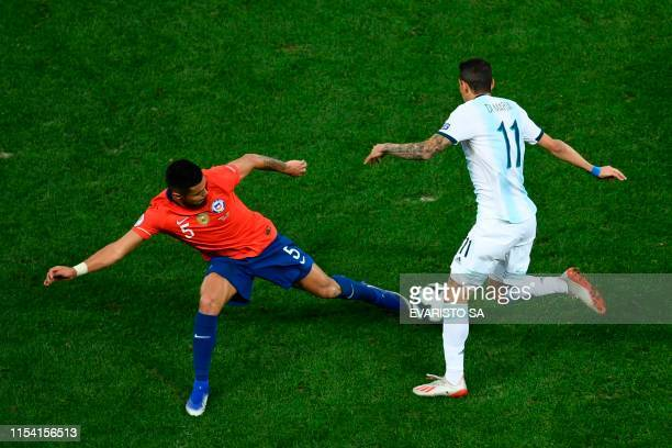 Chile's Paulo Diaz and Argentina's Angel Di Maria vie for the ball during their Copa America football tournament thirdplace match at the Corinthians...