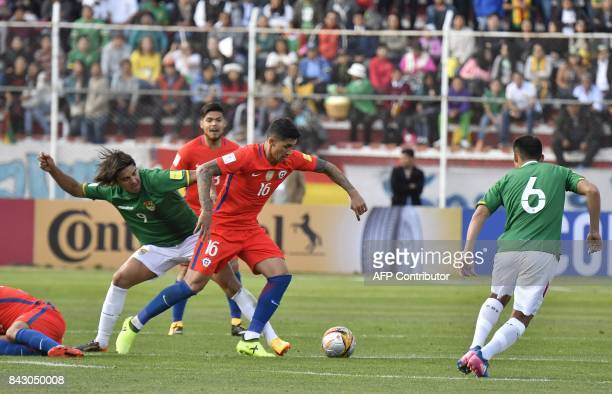 Chile's Pedro Pablo Hernandez vies for the ball with Bolivia's Marcelo Martins and Bolivia's Leonel Justiniano during their 2018 World Cup qualifier...