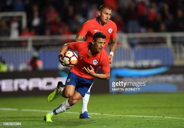 Chile's player Alexis Sanchez celebrates after scoring against Costa Rica during a friendly football match at El Teniente stadium in Rancagua Chile...