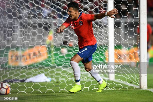 Chile's player Alexis Sanchez reacts after failing to score a penalty kick against Costa Rica during a friendly football match at El Teniente stadium...
