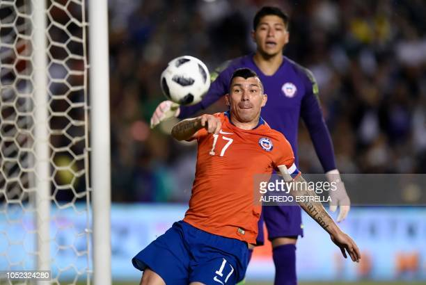 Chile's player Arturo Vidal controls the ball during their friendly football match at the La Corregidora stadium in Queretaro Mexico on October 16...