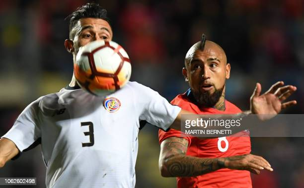Chile's player Arturo Vidal , vies for the ball with Costa Rica's player Bryan Ruiz, during their friendly football match, at El Teniente stadium, in...