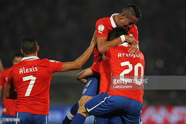 Chile's player Eduardo Vargas celebrates after scoring during a match against Venezuela as part of the 15th round of the South American Qualifiers at...