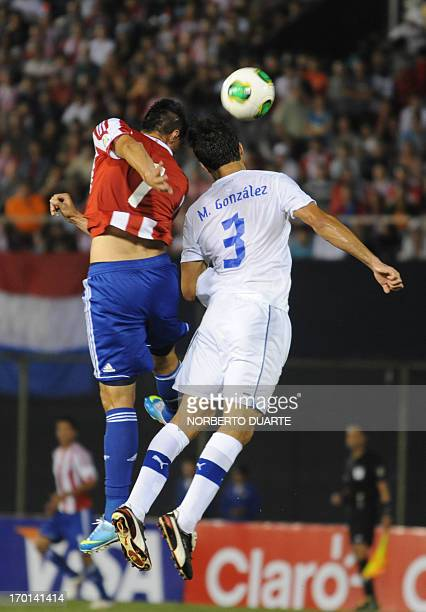 Chile's player Marcos Gonzalez vies for the ball with Paraguay's Oscar Cardozo during a Brazil 2014 FIFA World Cup South American qualifying match at...
