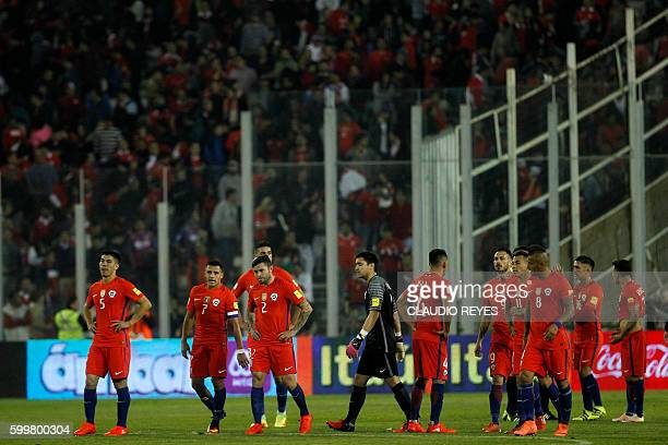 Chile's player show their dejection after tying 00 with Bolivia in a Russia 2018 World Cup football qualifier match in Santiago on September 6 2016 /...