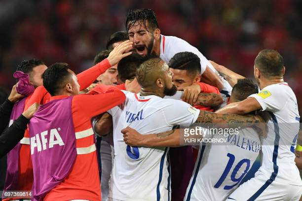 Chile's players celebrate their second goal during the 2017 Confederations Cup group B football match between Cameroon and Chile at the Spartak...