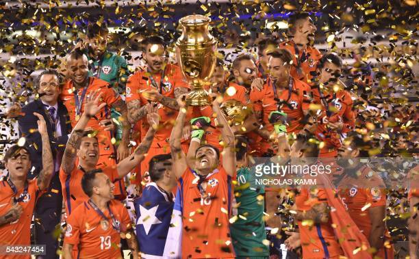 Chile's players celebrate with the trophy after winning the Copa America Centenario final by defeating Argentina in the penalty shoot-out in East...